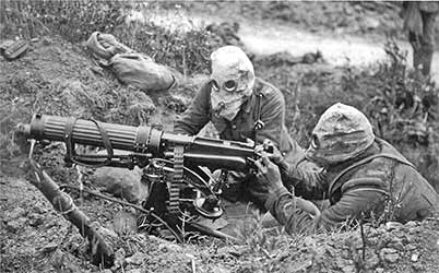 British soldiers in gas masks at a machine gun