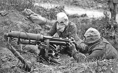 British soldiers in gas masks at a machine gun